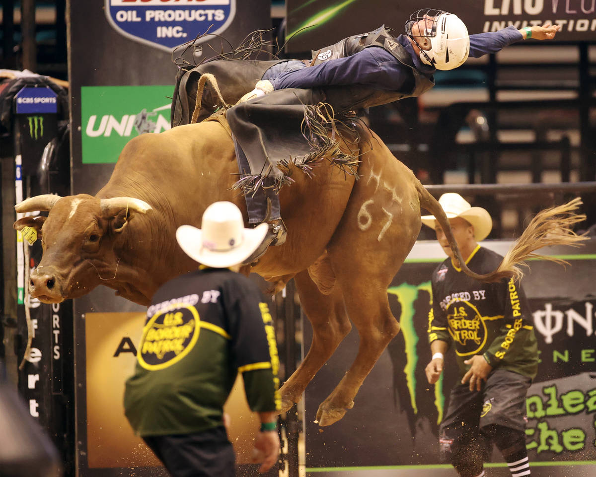 Bull rider Taylor Toves competes during the Professional Bull Riders Las Vegas Invitational at ...