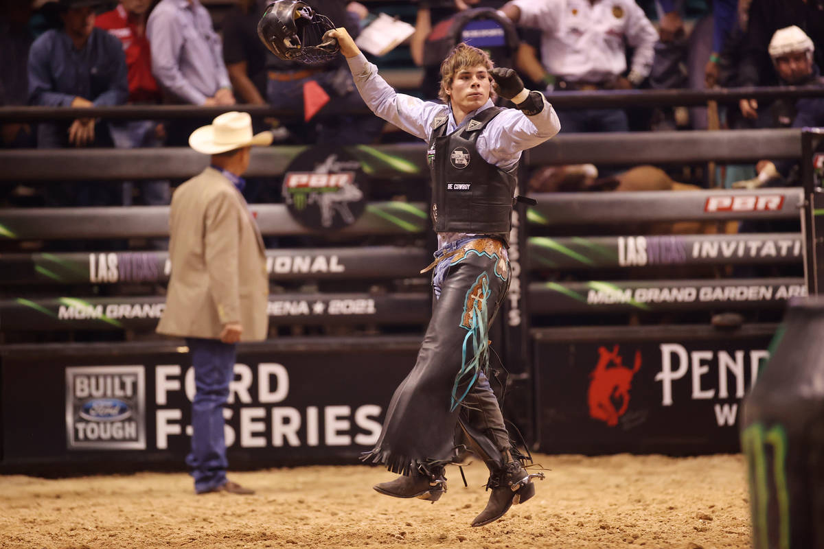 Bull rider Conner Halverson reacts after his run during the Professional Bull Riders Las Vegas ...