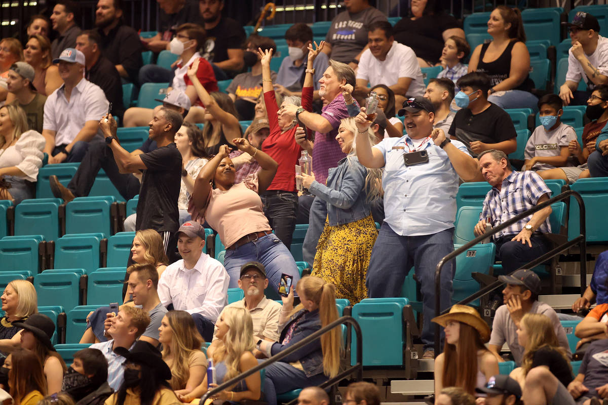 People dance during the Professional Bull Riders Las Vegas Invitational at the MGM Grand Garden ...