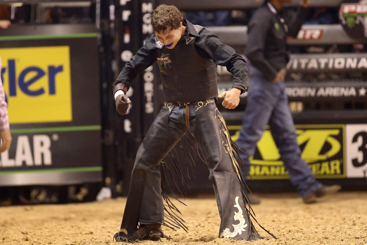 Bull rider Austin Richardson reacts after his run during the Professional Bull Riders Las Vegas ...