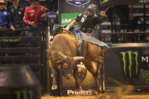 Bull rider Claudio Montanha Jr. competes during the Professional Bull Riders Las Vegas Invitati ...
