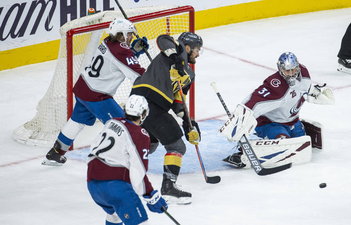 Golden Knights left wing William Carrier (28) readies to score over Colorado Avalanche goaltend ...