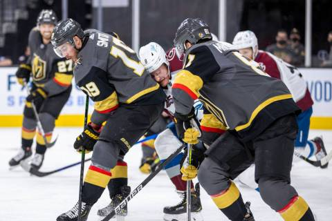 Golden Knights right wing Reilly Smith (19) and teammate center Jonathan Marchessault (81) sand ...