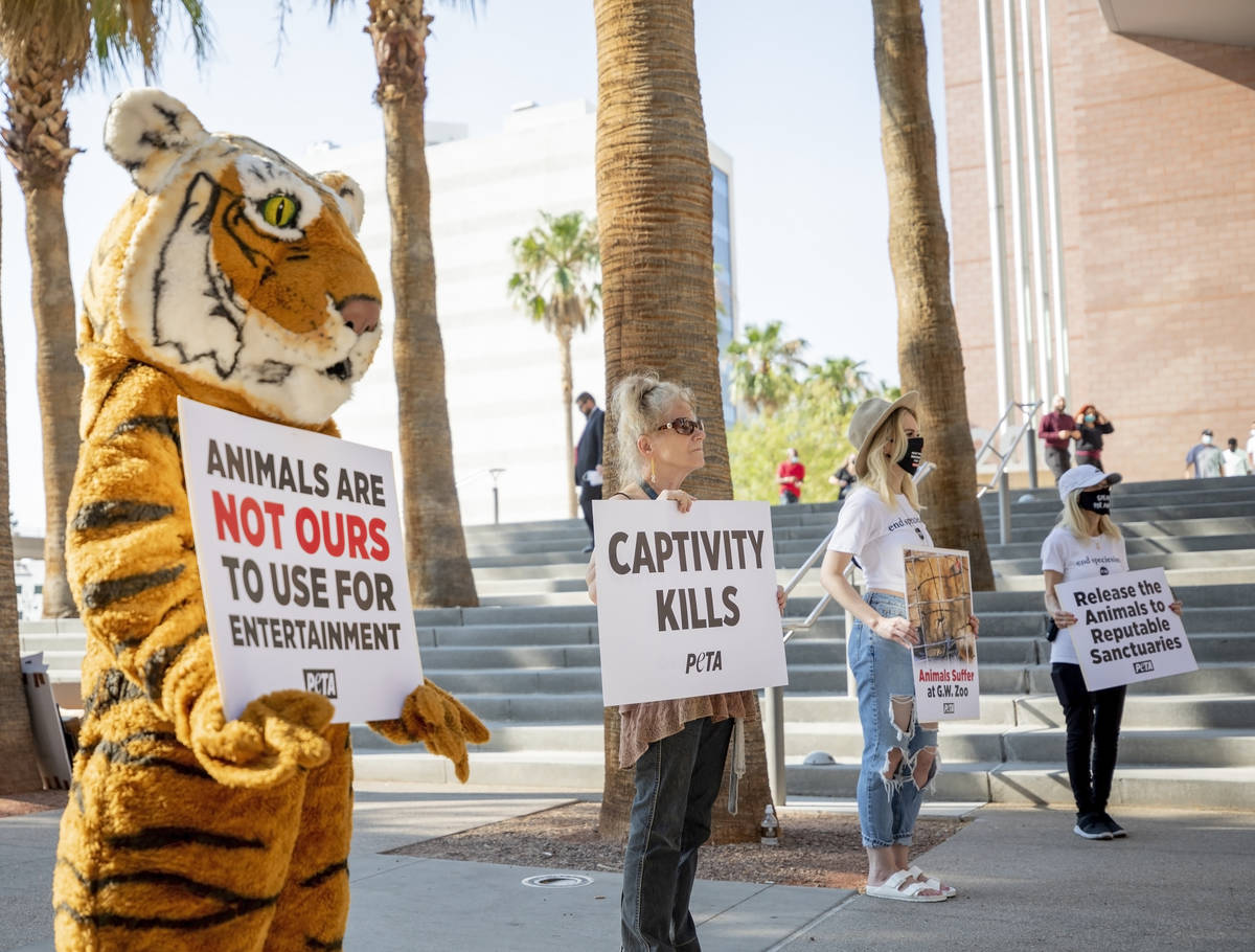 Activists protest animal exhibitor Jeff Lowe, best known for his role in the Netflix documentar ...