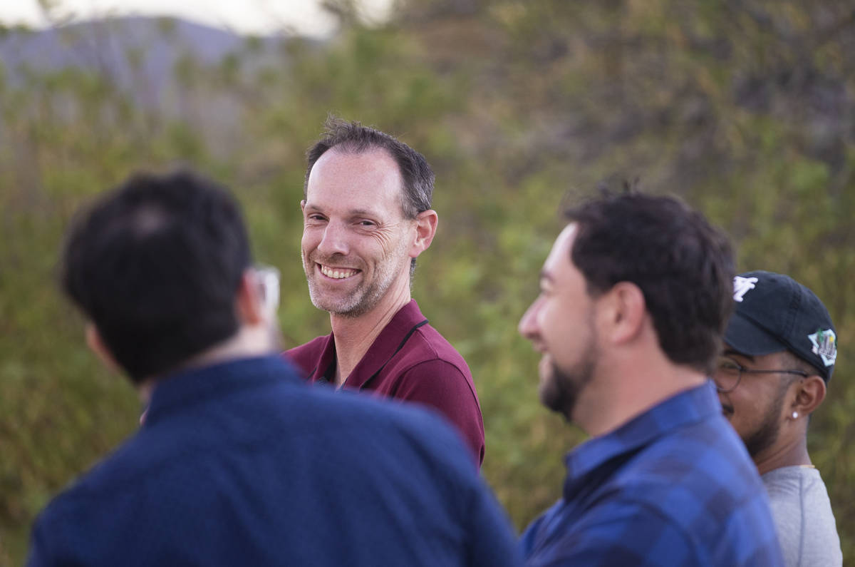 Clark County Commissioner Justin Jones, center, speaks with attendees during an event to discus ...