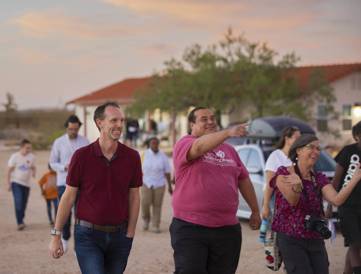 Clark County Commissioner Justin Jones, left, takes a tour of Walking Box Ranch during an event ...
