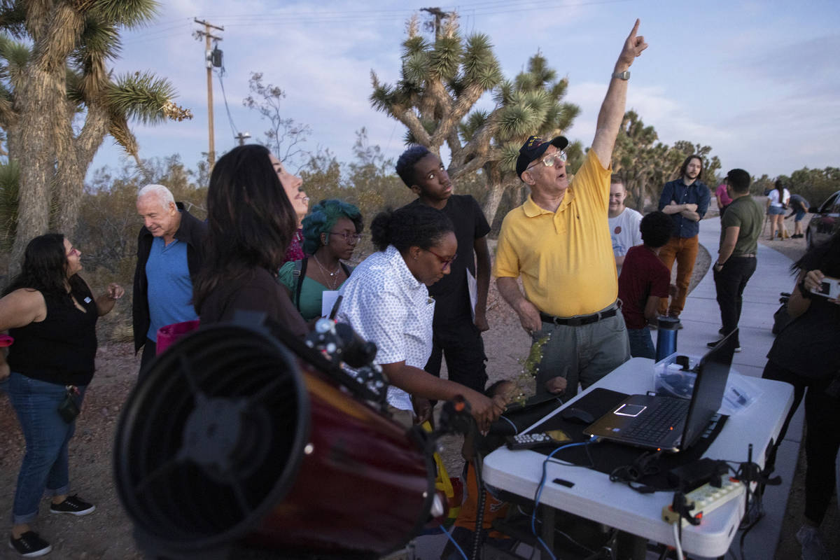 Bill Krause, with the Las Vegas Astronomical Society, shows attendees the photos he's taken wit ...