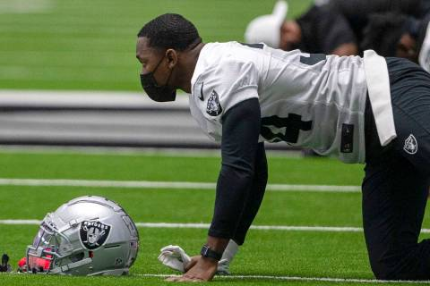 Las Vegas Raiders defensive back Kemah Siverand (34) wears a mask while stretching during a pra ...