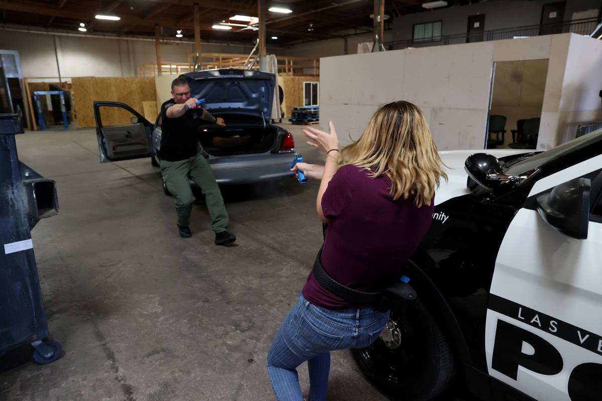 Las Vegas Review-Journal reporter Katelyn Newberg confronts a suspect during a traffic stop du ...