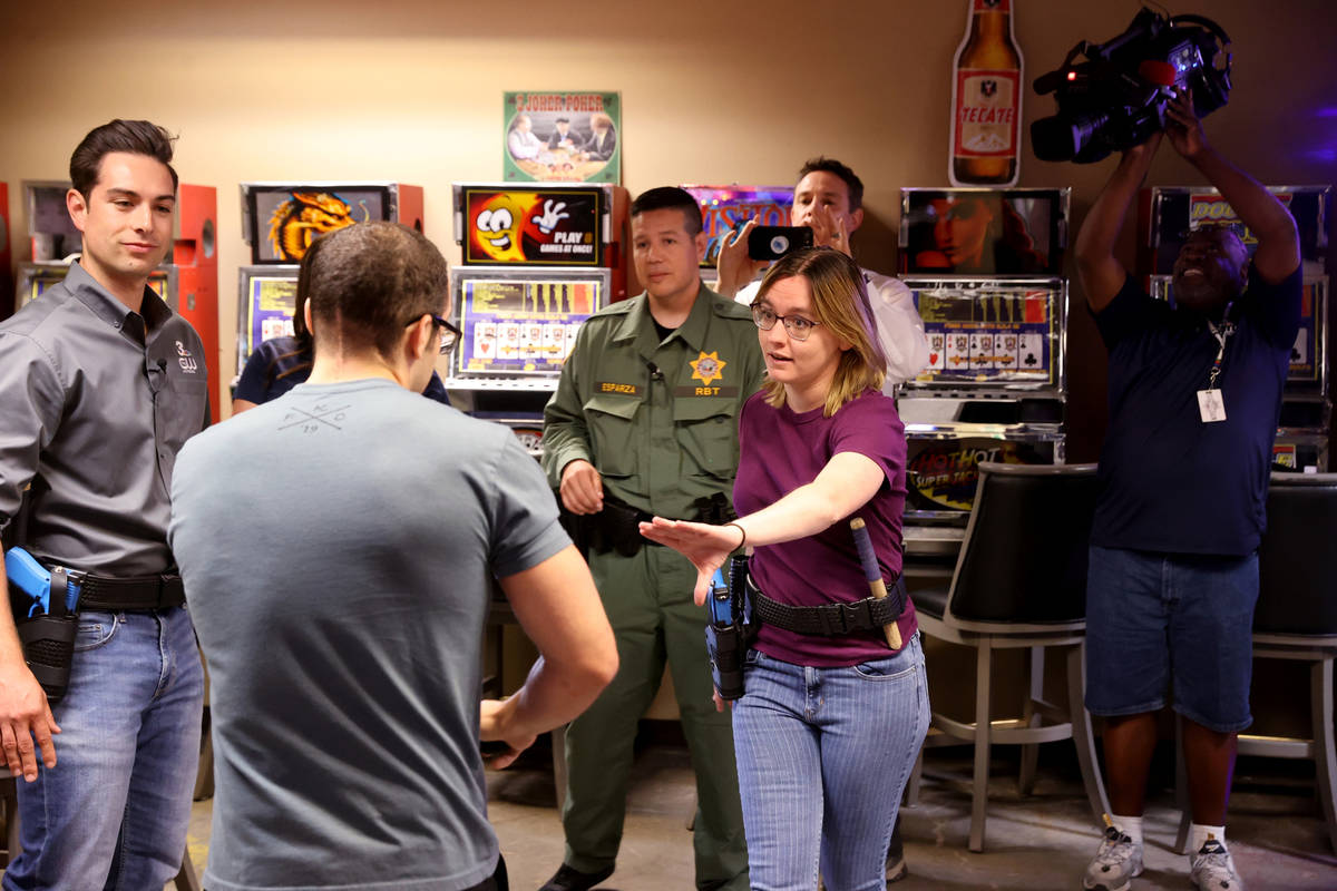 Las Vegas Review-Journal reporter Katelyn Newberg attempts to de-escalate during a scenario at ...