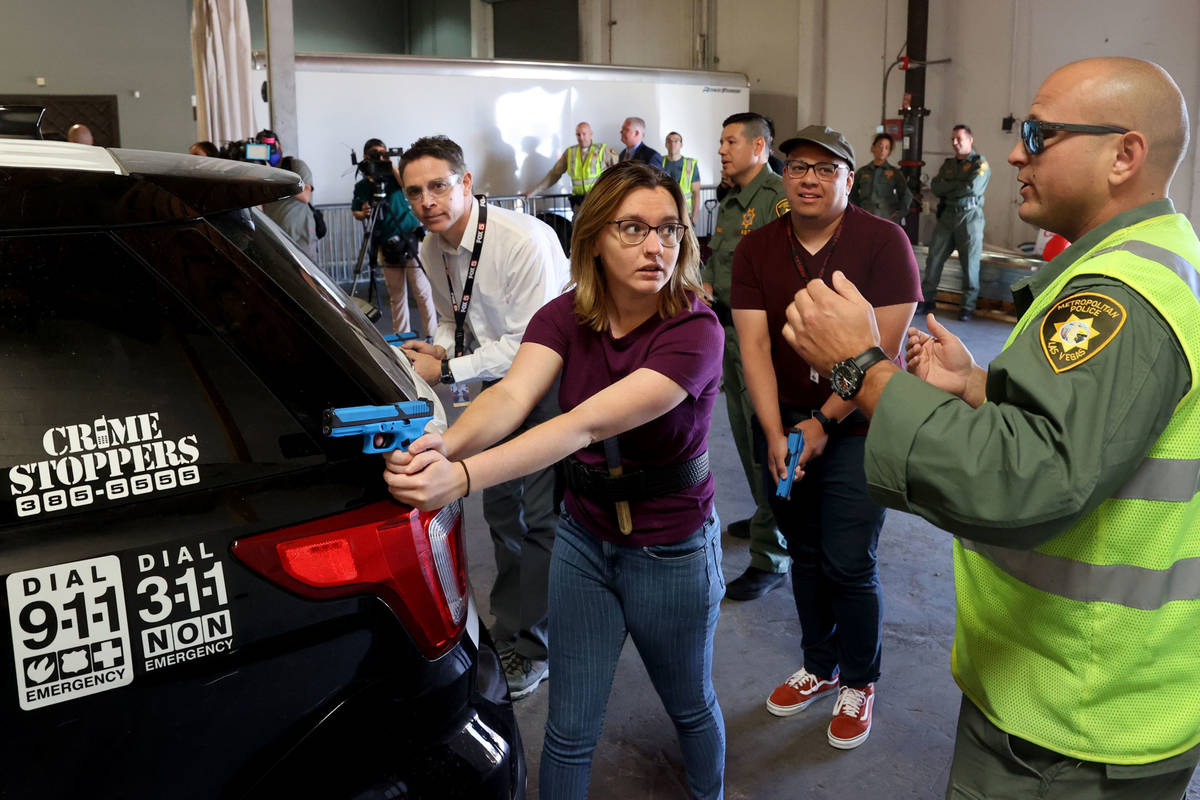 Las Vegas Review-Journal reporter Katelyn Newberg gives instructions to a suspect with Las Vega ...
