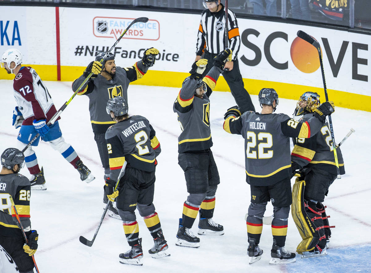 Golden Knights goaltender Marc-Andre Fleury (29) and teammates celebrate their 6-3 win over the ...