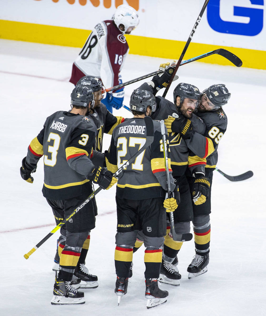 Golden Knights left wing William Carrier (28) is hugged by Golden Knights right wing Alex Tuch ...