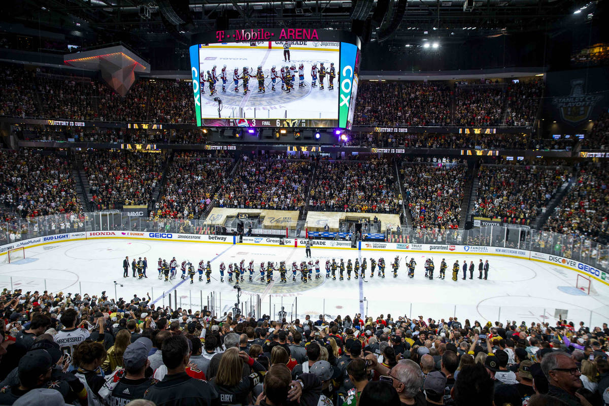 Players come together after the Golden Knights defeat the Colorado Avalanche 6-3 following the ...