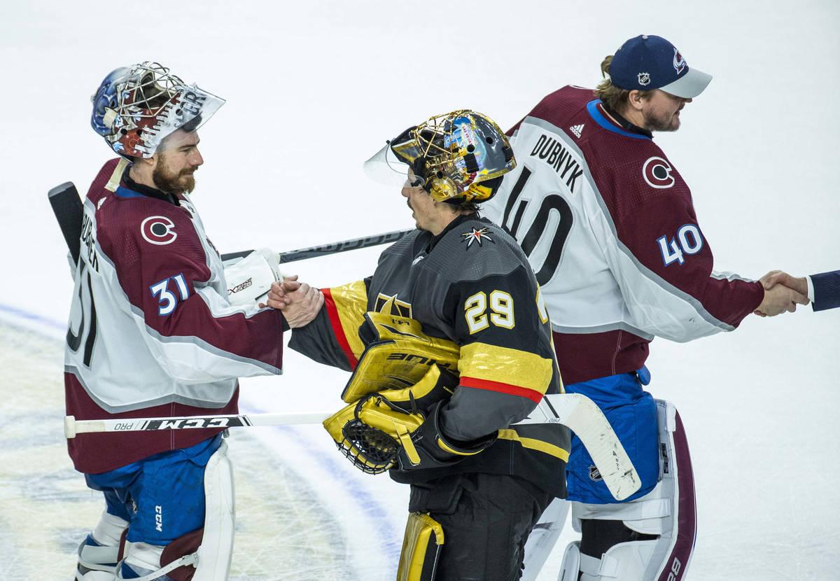 Golden Knights goaltender Marc-Andre Fleury (29) and Colorado Avalanche goaltender Philipp Grub ...