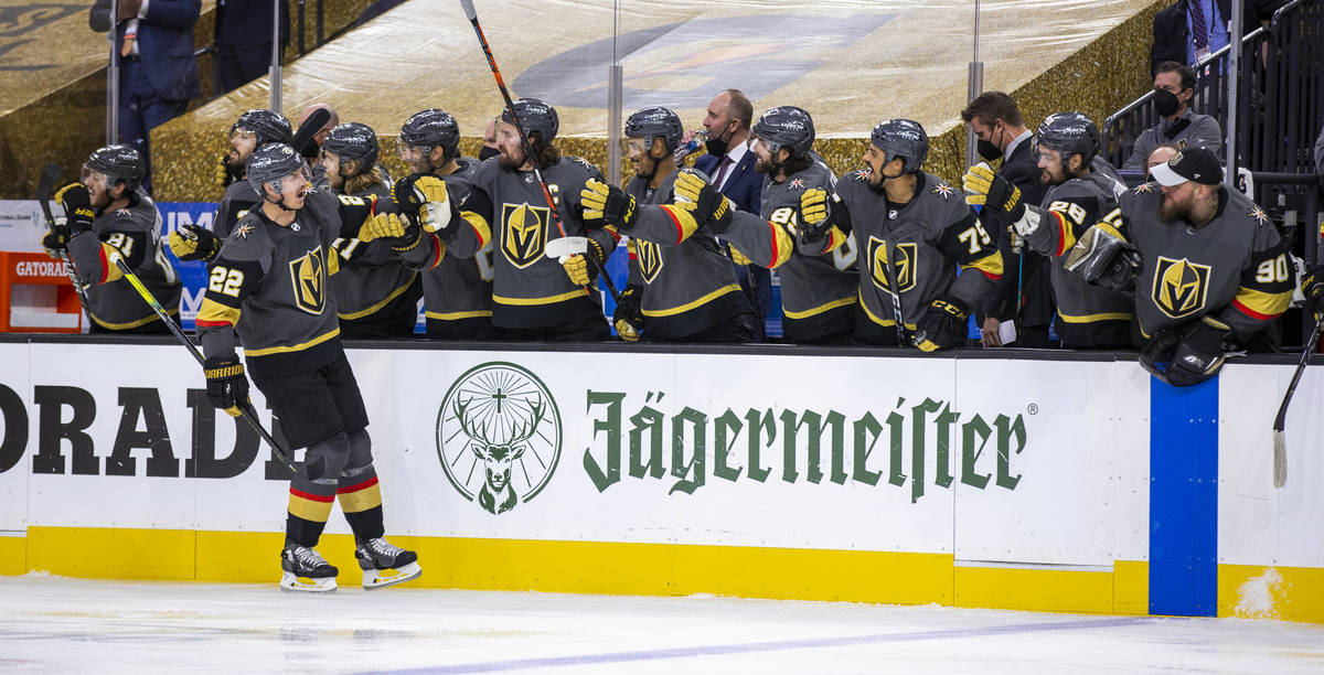 Golden Knights defenseman Nick Holden (22) celebrates his goal with teammates during the first ...