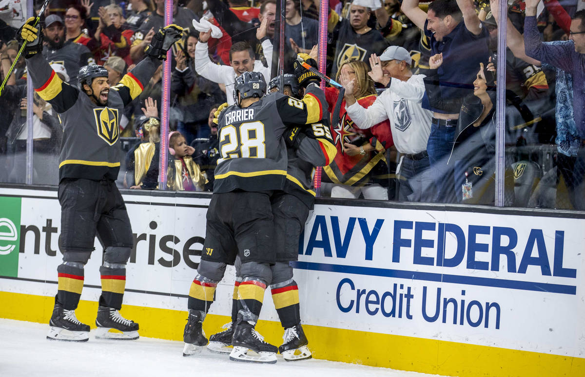 Golden Knights right wing Ryan Reaves (75) celebrates a goal with teammates left wing William C ...