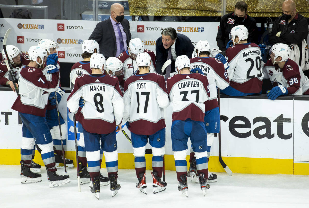 Colorado Avalanche head coach Jared Bednar designs a play for his players during the third peri ...