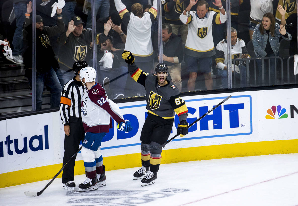 Golden Knights left wing Max Pacioretty (67) yells in elation after scoring over the Colorado A ...
