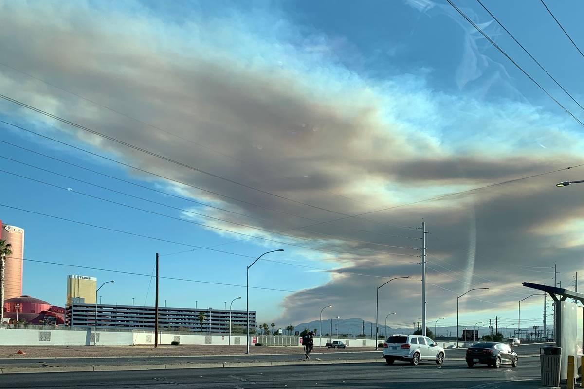 A fire on Potosi Mountain is seen from Sahara Avenue near I-15 in Las Vegas on Thursday, June 1 ...