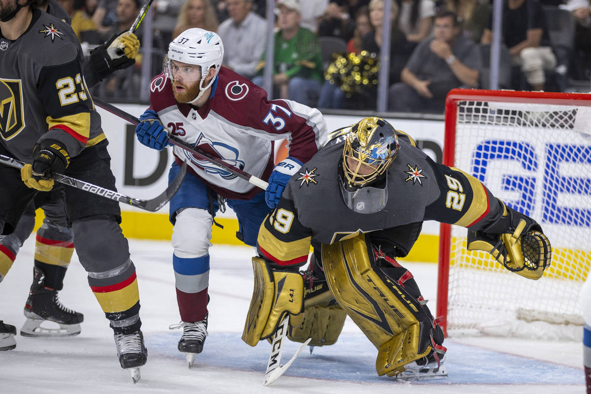 Colorado Avalanche left wing J.T. Compher (37) and Golden Knights goaltender Marc-Andre Fleury ...