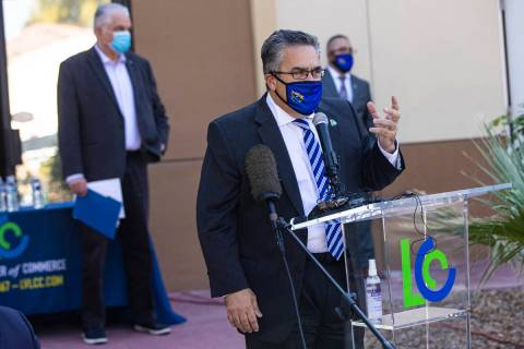 Peter Guzman, president of the Latin Chamber of Commerce, speaks during a press conference anno ...