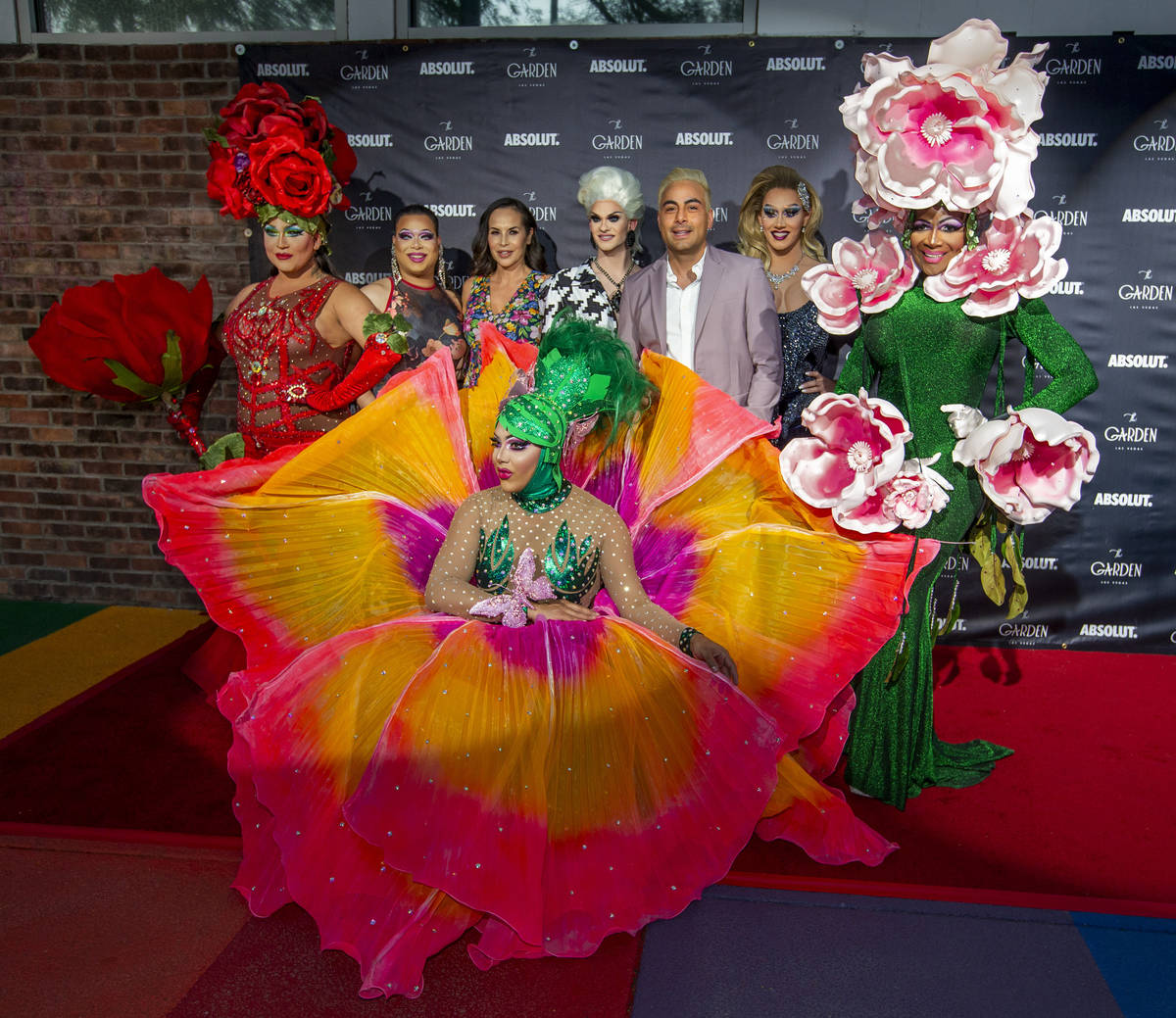 Performers gather about owner Eduardo Cordova, center, on the red carpet as alternative lifesty ...