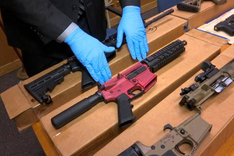 """In this file photo taken Wednesday, Nov. 27, 2019, is Sgt. Matthew Elseth with """"ghost guns"""" on ..."""