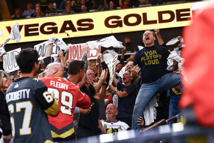 Entertainer Cameron Hughes, right, hypes up the crowd during the third period of Game 4 of an N ...