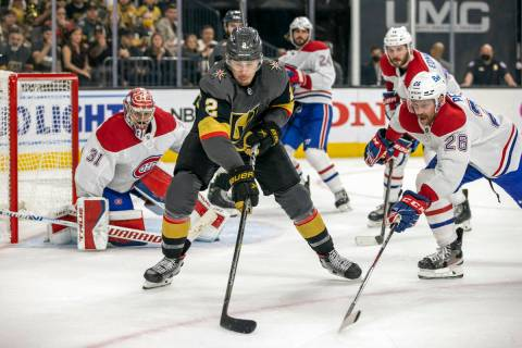 Golden Knights defenseman Zach Whitecloud (2) secures the puck over Montreal Canadiens defensem ...