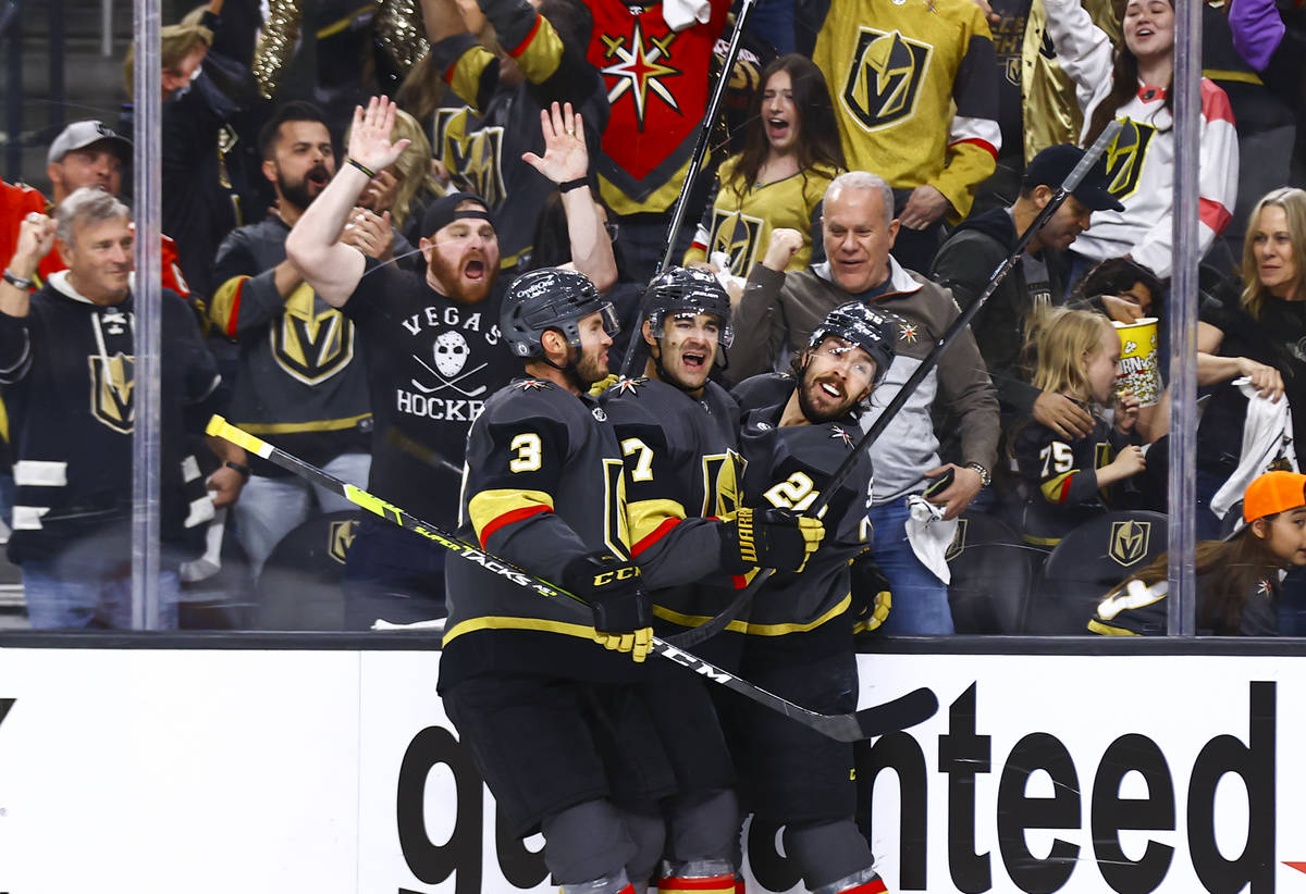 The Golden Knights' Max Pacioretty (67) celebrates his goal with Brayden McNabb (3) and Chandle ...