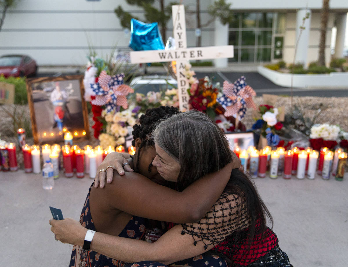Joan Anderson, right, Walter Anderson's sister, hugs Charis Jimmons, his neighbor, at a vigil ...