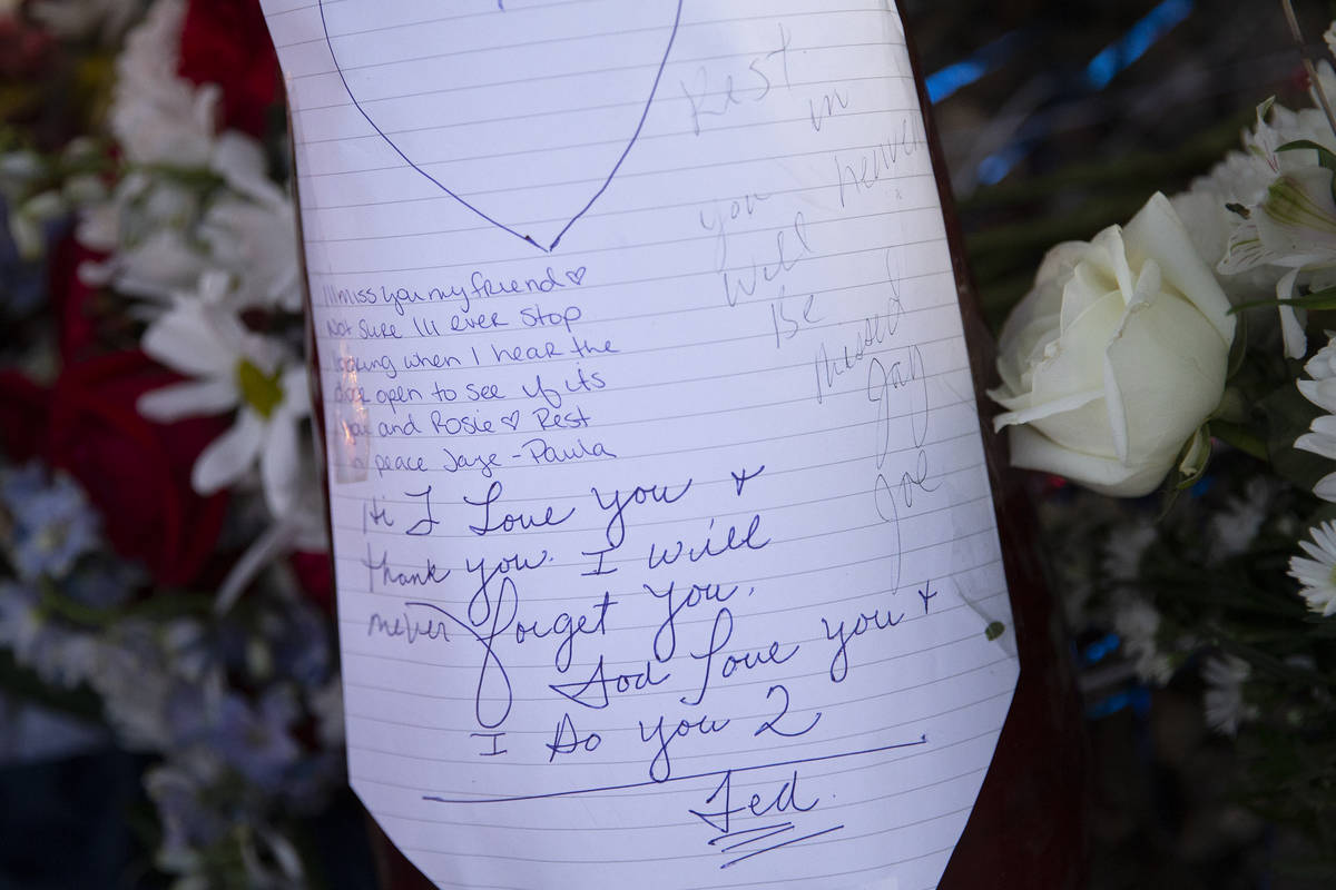 Loving notes are written at a vigil for Walter Richard Anderson near the intersection where he ...