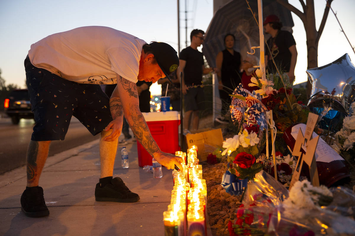 Sheldon Cooper, a close friend of Walter Anderson's son Ryan, keeps the candles lit at a vigil ...