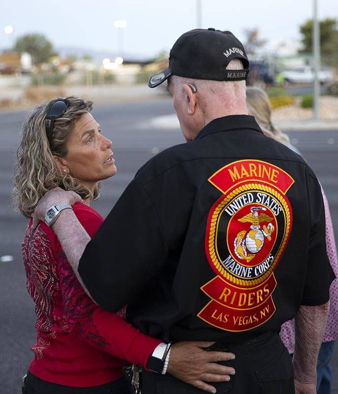 Lisa Anderson hugs her father John Anderson at a vigil for their brother and son Walter Anderso ...