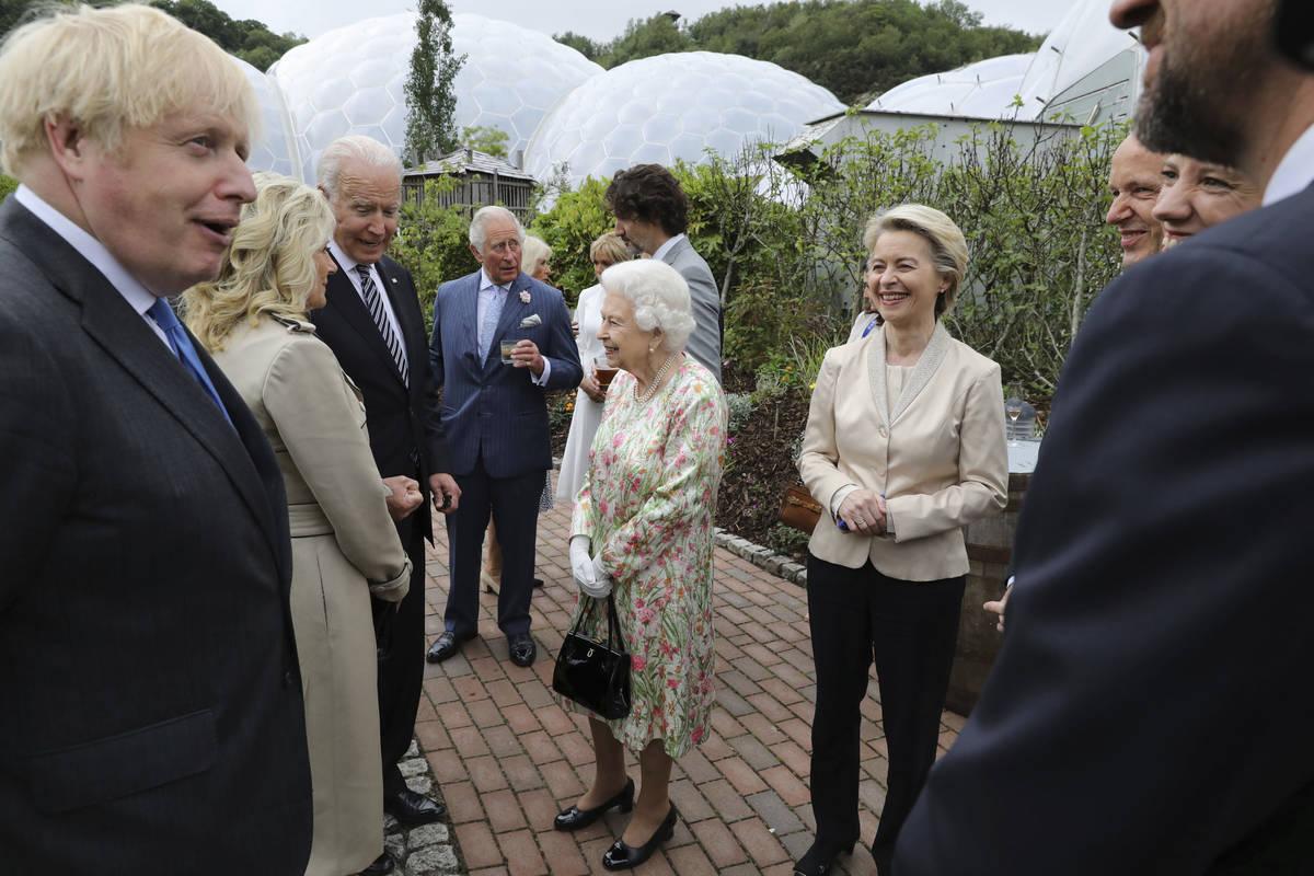 Britain's Queen Elizabeth II speaks to President Joe Biden and his wife Jill Biden during recep ...