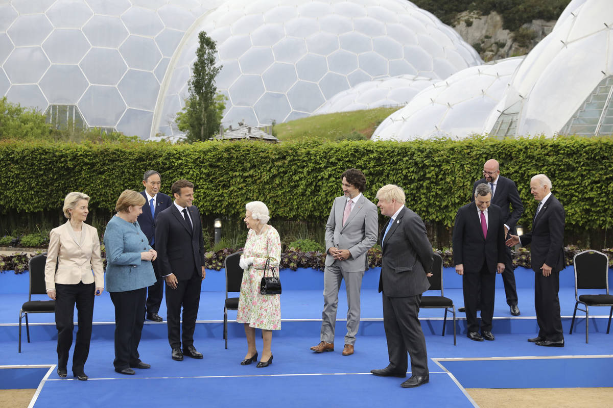 Britain's Queen Elizabeth II talks with G7 leaders, from left, back row, President of the Europ ...