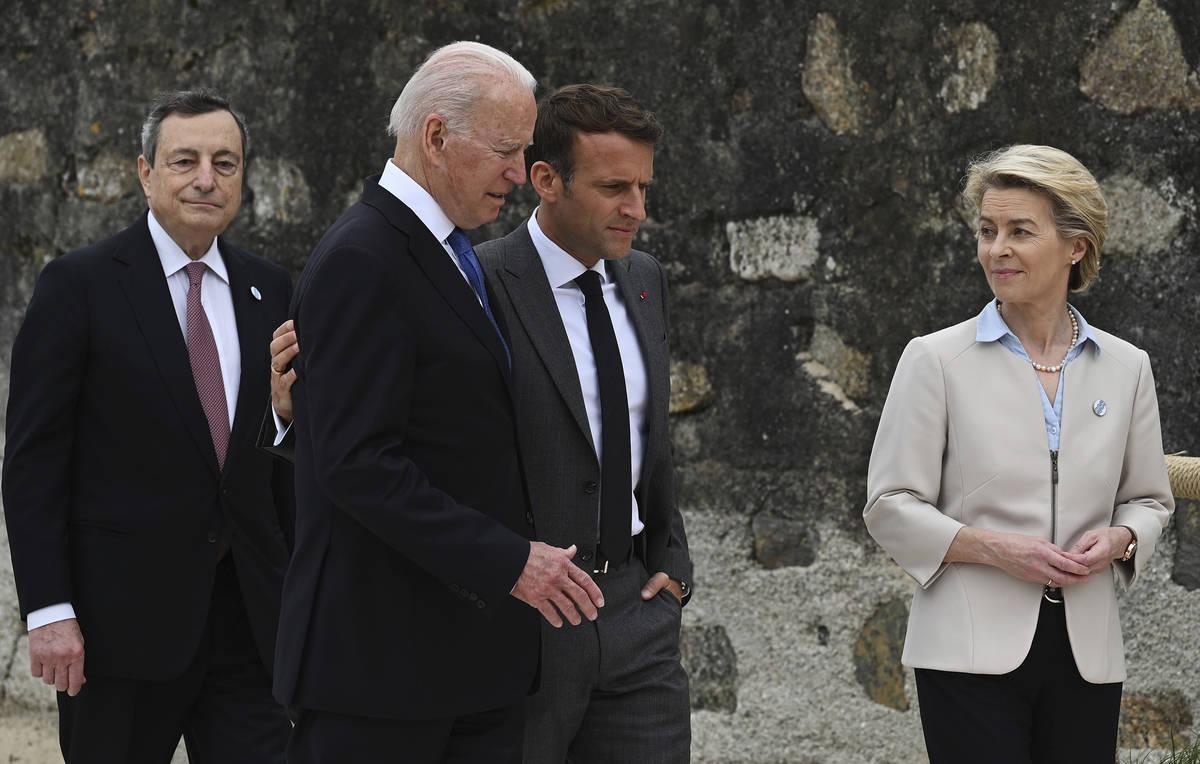 From left, Italian Prime Minister Mario Draghi, US President Joe Biden, President of France, Em ...