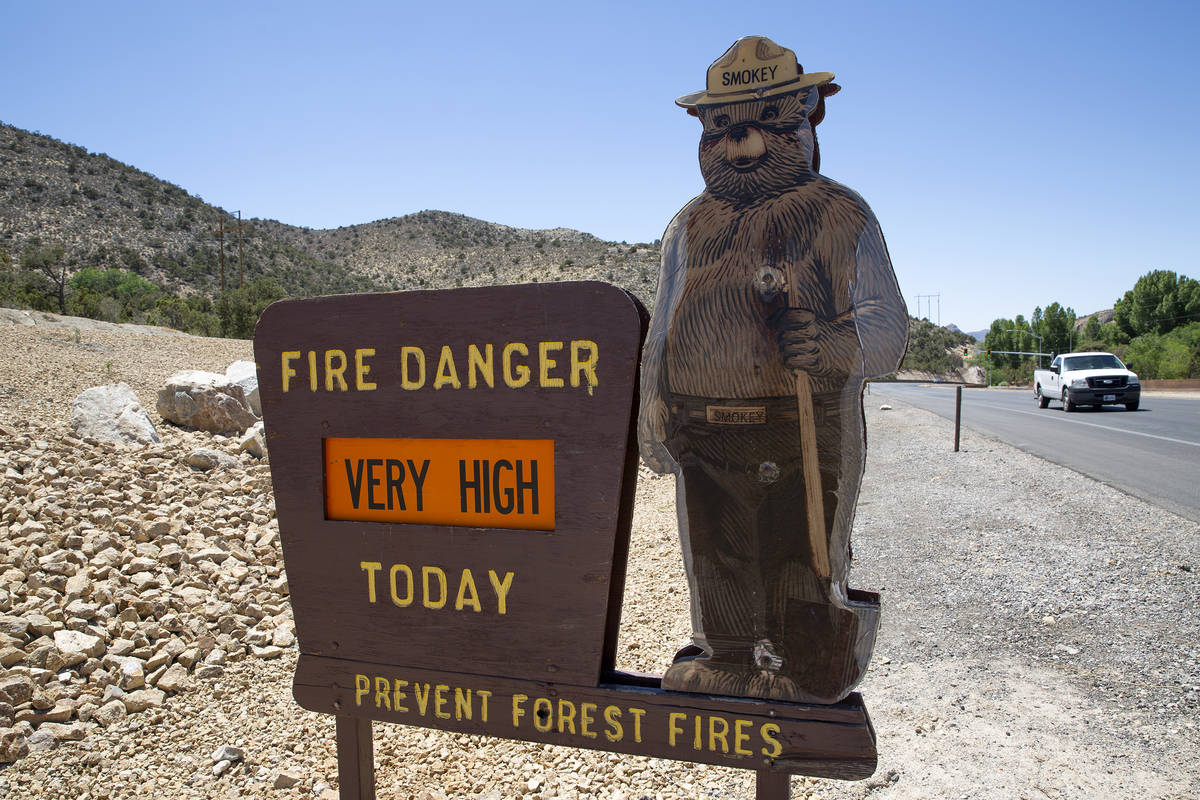 A Smokey the Bear sign indicates very high fire danger along State Route 160 on Saturday, June ...