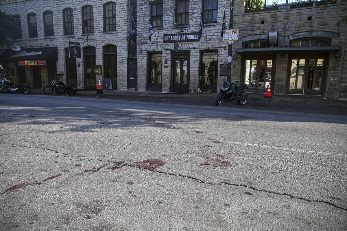 Blood stains remain on 6th Street after an early morning shooting on Saturday, June 12, 2021 in ...