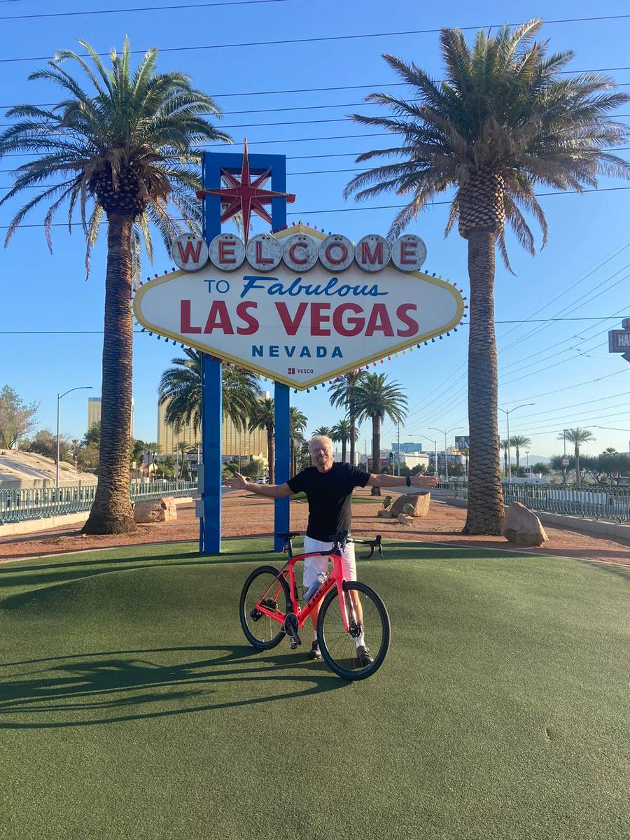 Virgin Group founder Richard Branson is shown at the Welcome to Fabulous Las Vegas sign during ...