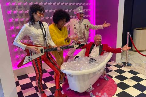 Virgin Group founder Richard Branson is shown at Virgin Hotels Las Vegas' replica bubble-bath o ...