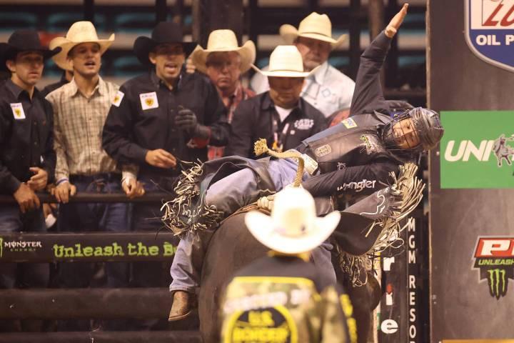 Bull rider Dener Barbosa competes during the Professional Bull Riders Las Vegas Invitational at ...