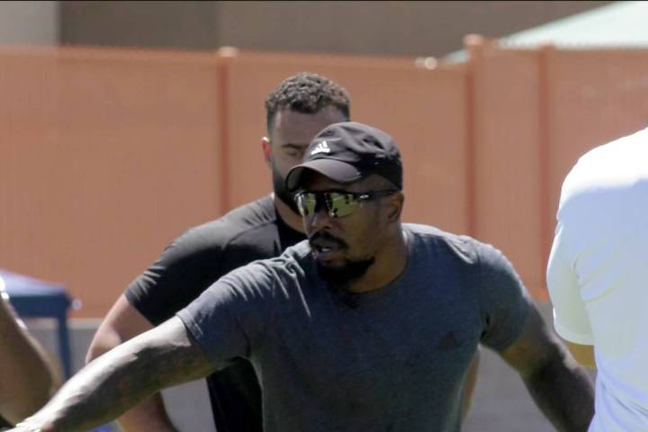 This screenshot shows Broncos Linebacker Von Miller demonstrating pass rush techniques to atten ...
