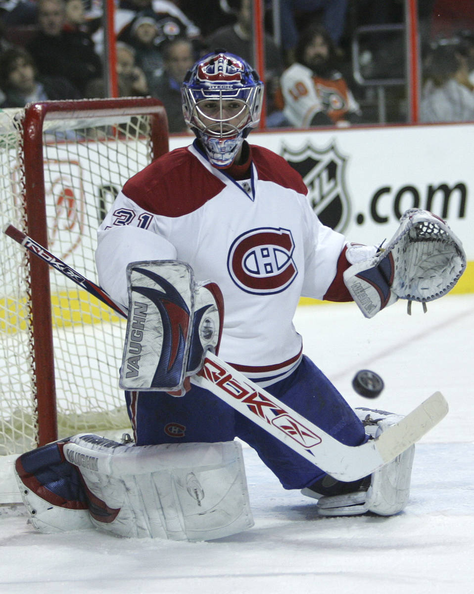 Montreal Canadiens' goalie Cary Price deflects the puck on a shot by the Philadelphia Flyers i ...