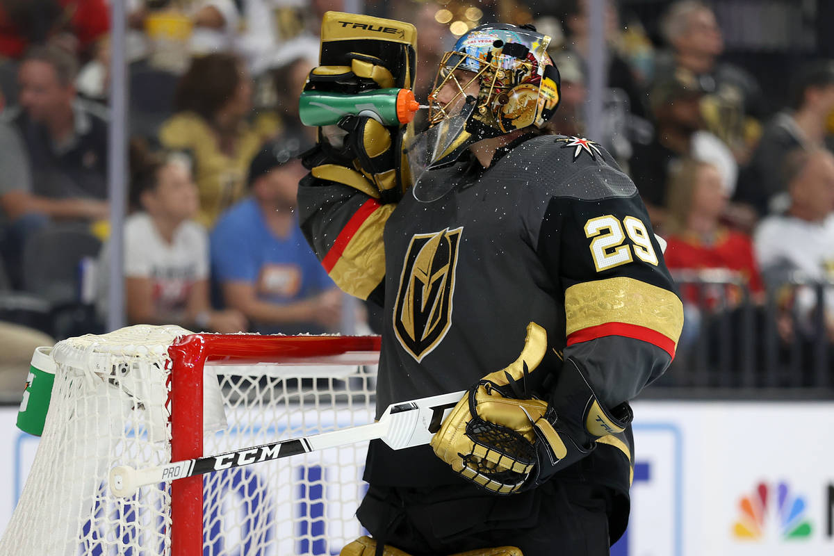 Vegas Golden Knights goaltender Marc-Andre Fleury (29) drinks water during a break in the secon ...