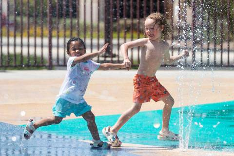 Heavynn Bradford, 2, left, plays with Zane Peters, 4, at Paseo Vista Park, on Wednesday, June 2 ...