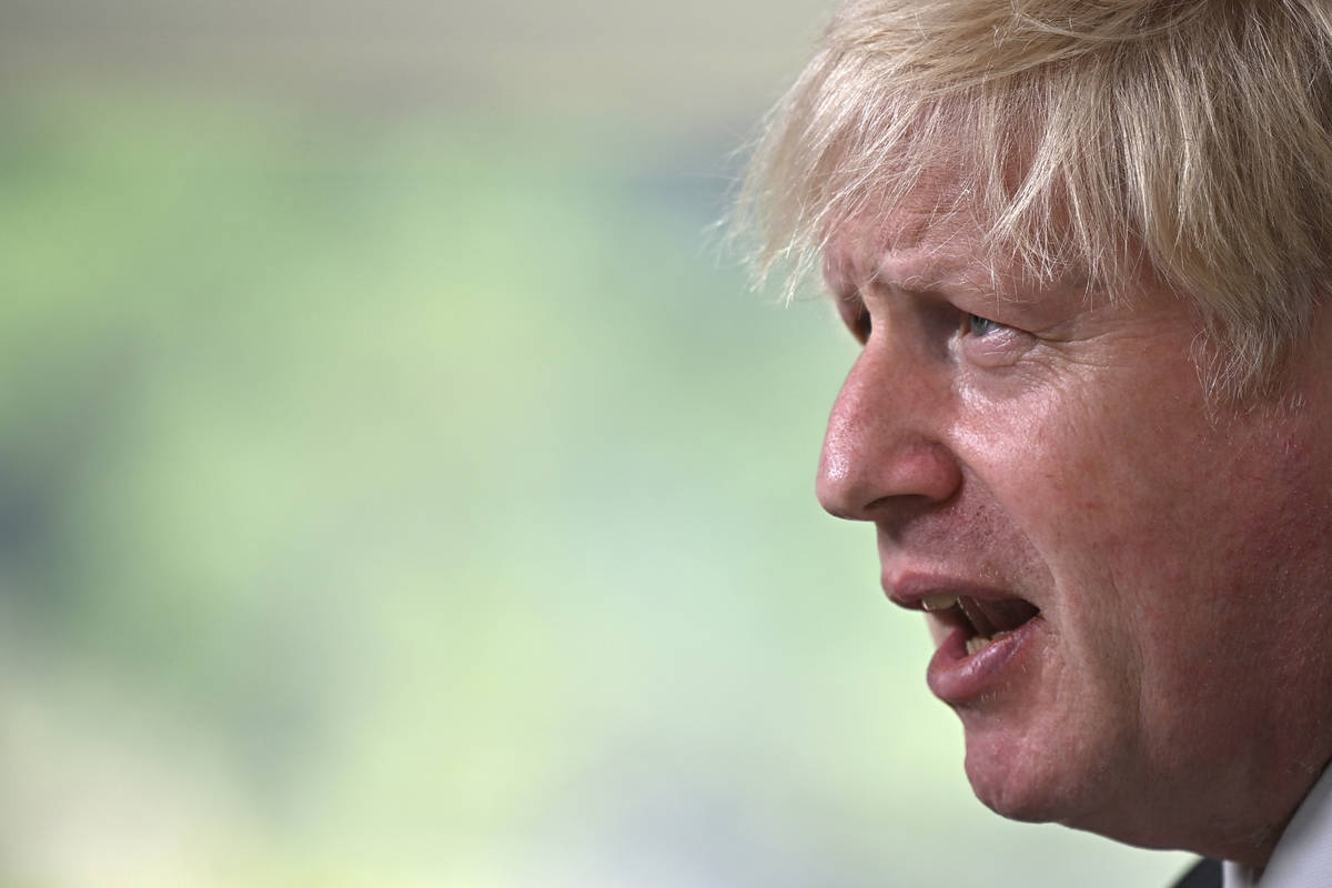 Britain's Prime Minister Boris Johnson speaks, during a press conference on the final day of th ...