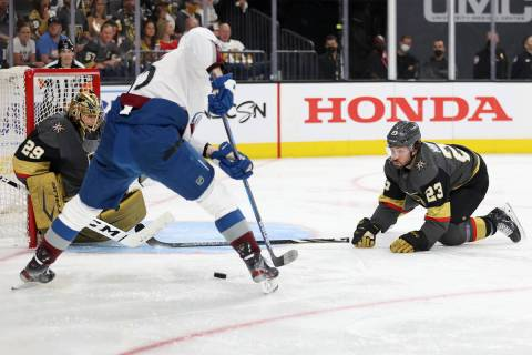 Vegas Golden Knights goaltender Marc-Andre Fleury (29) and Vegas Golden Knights defenseman Alec ...
