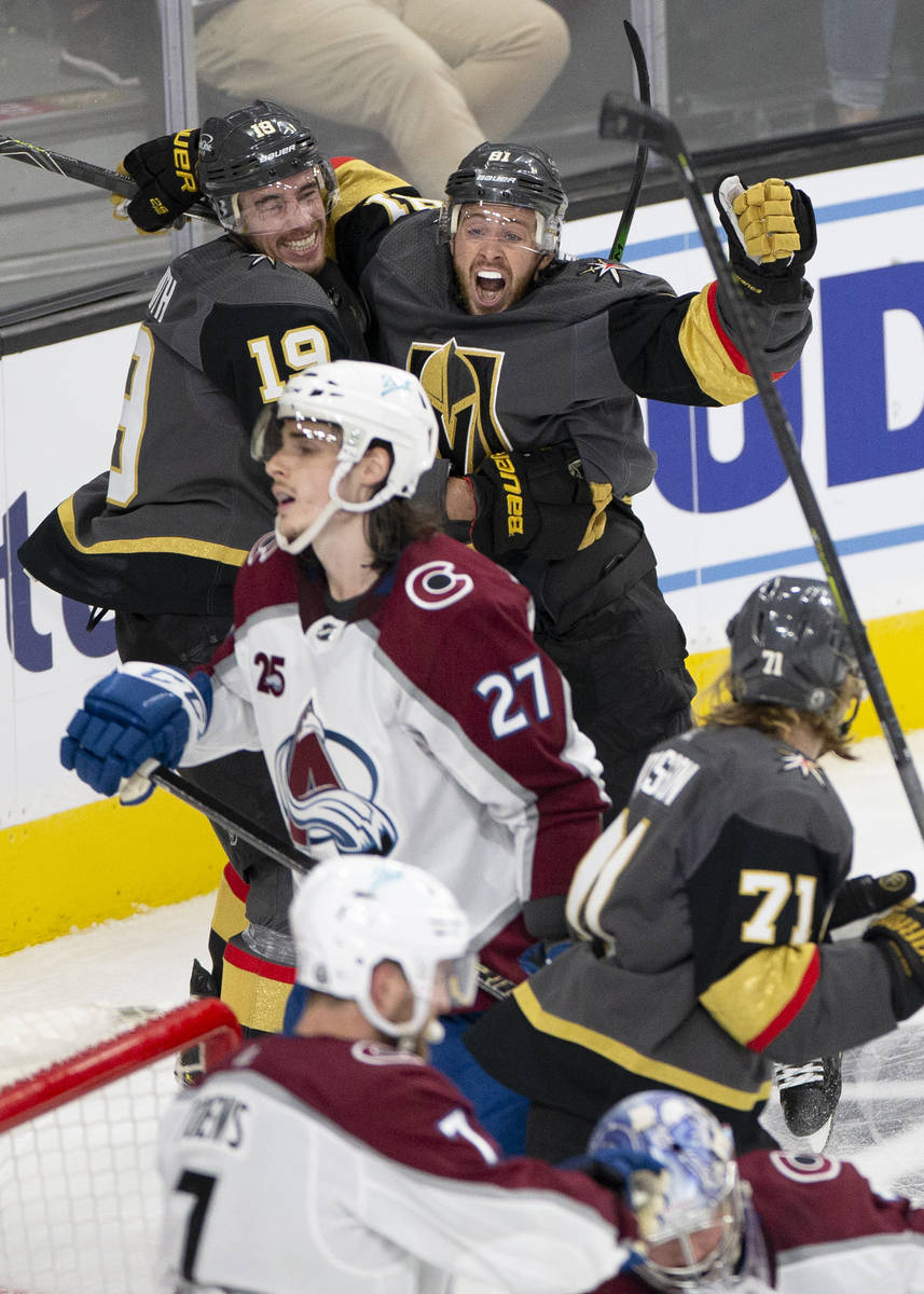 Golden Knights right wing Reilly Smith (19) embraces Golden Knights center Jonathan Marchessaul ...